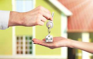 keys to a property being passed from one person to another