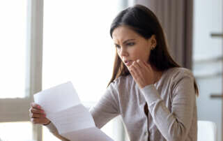 A puzzled woman looking at a document