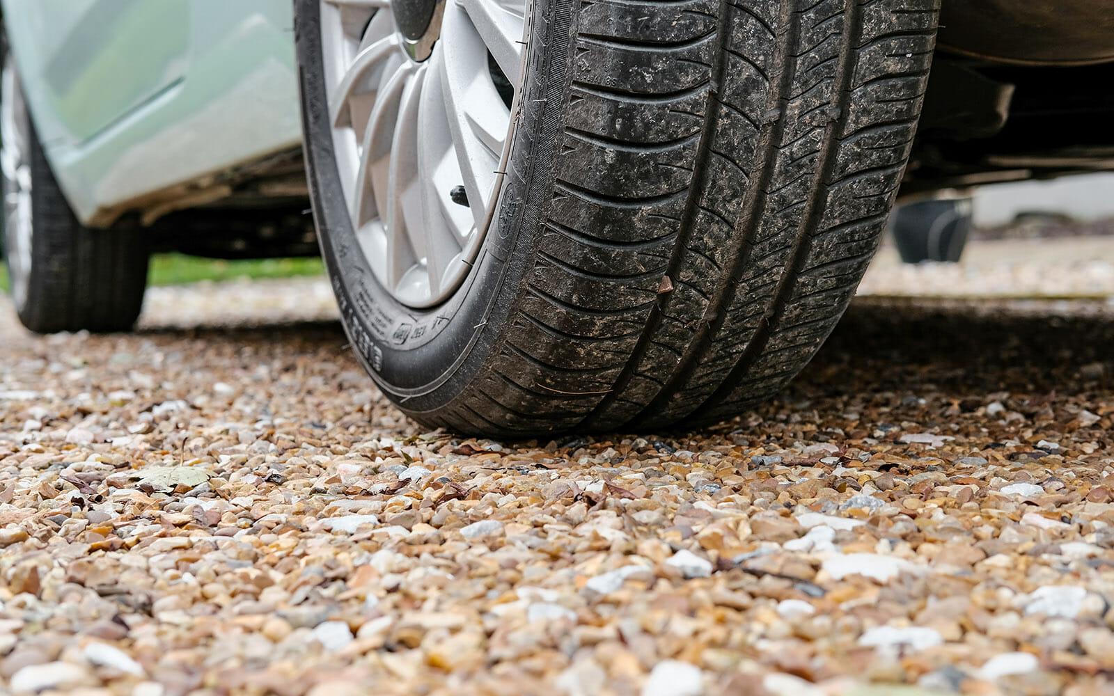 car parked on gravel